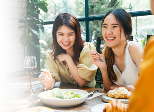 Two women after fat reduction service